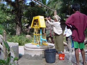 Villagers are using thier new water pump