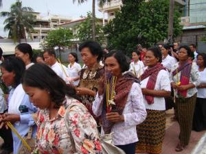 With sad faces and some even cry, S-21 victim's relative march to the monument which is built to remind about how cruel the Pol Pot regime is / by: Dara Saoyuth