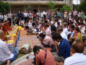 Attendees bow down to the floor and salute monks pray for thier relatives who have died during Khmer Rouge Regime to live in peace and happiness / by: Dara Saoyuth