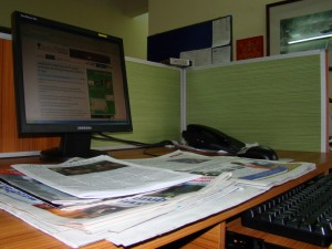 This is my place during my intern at AFP, and papers on the desk are what I have to read every morning / by: Dara Saoyuth