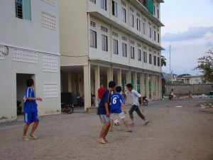 Cambodian Students who stay in dorm are playing football in front of their building in the evening / Photo by: Koam Tivea